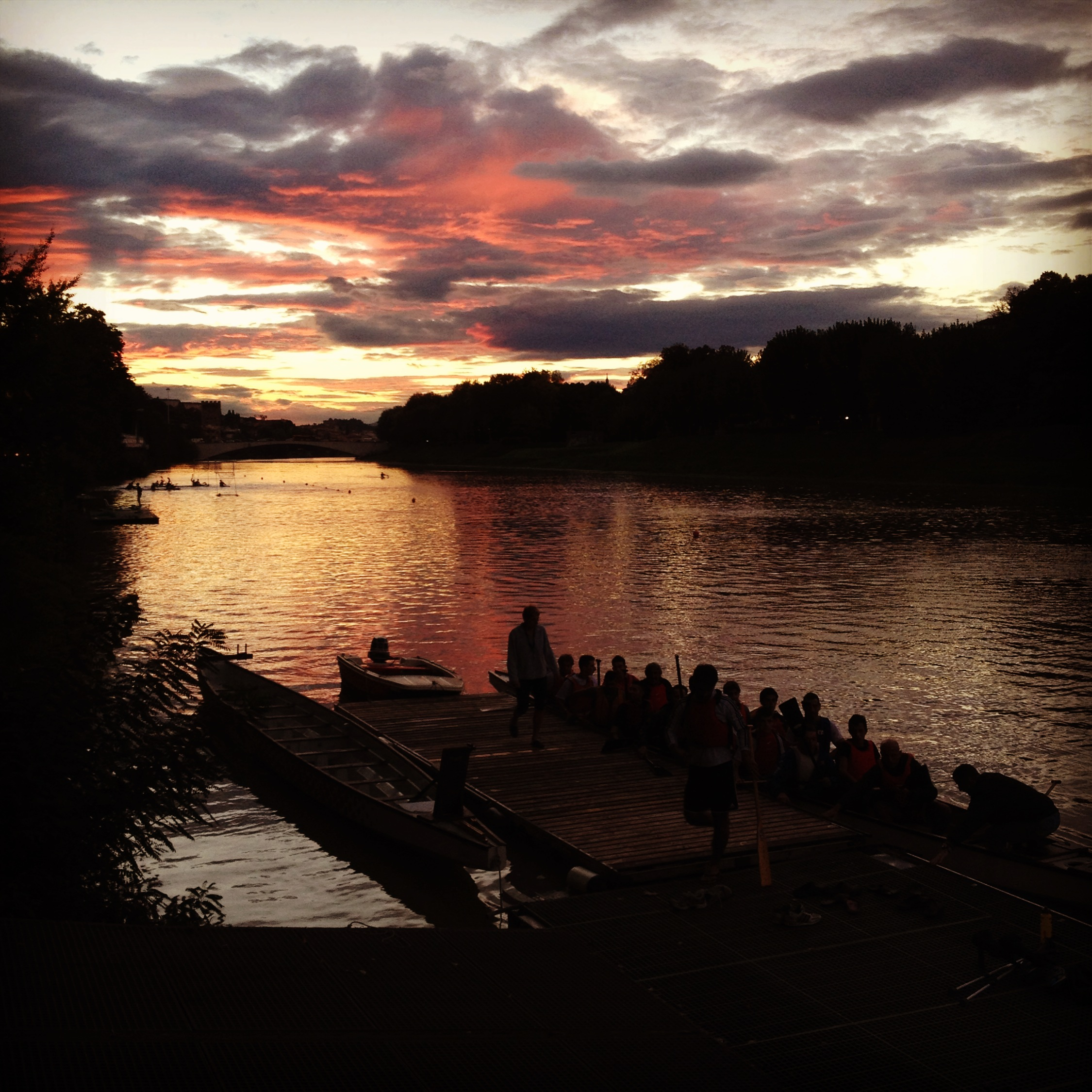 Dragonboat racing on the Arno at sunset.