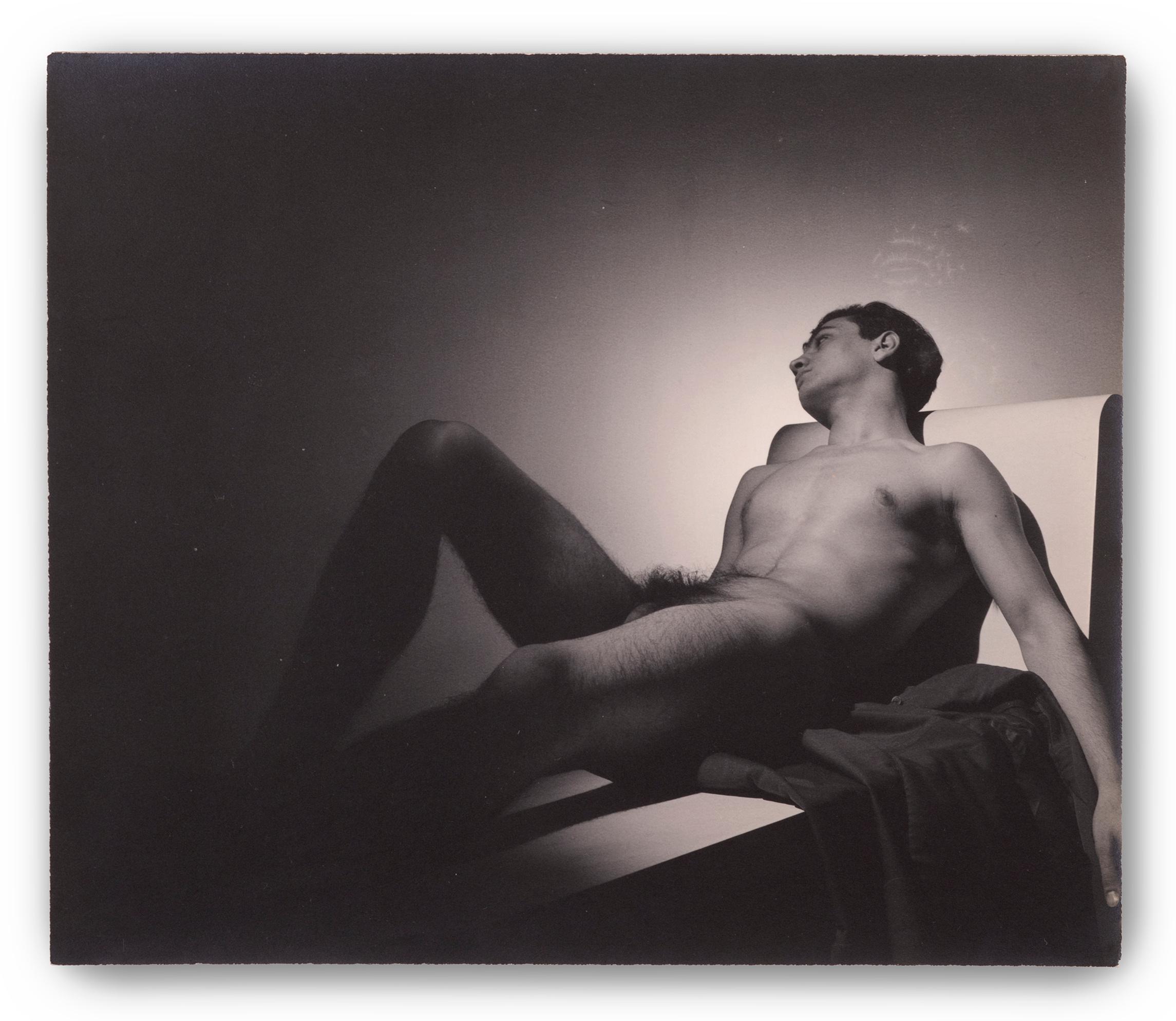 George Platt Lynes, (American 1907-1955), Reclining Nude (Mark Pagano), 1944.
