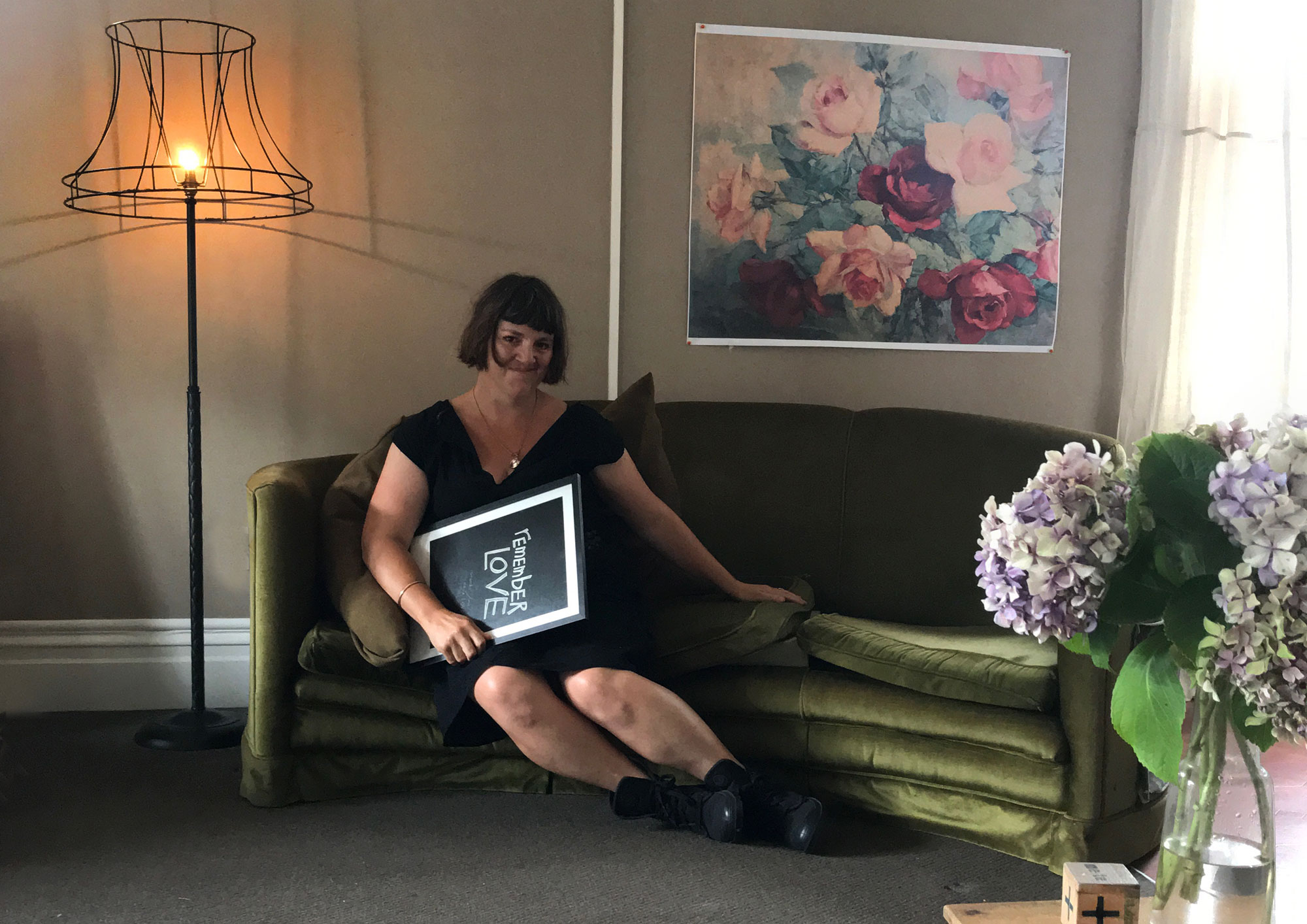 Me in my lounge (the site for the exhibition) along with testprints for the show, January 2018