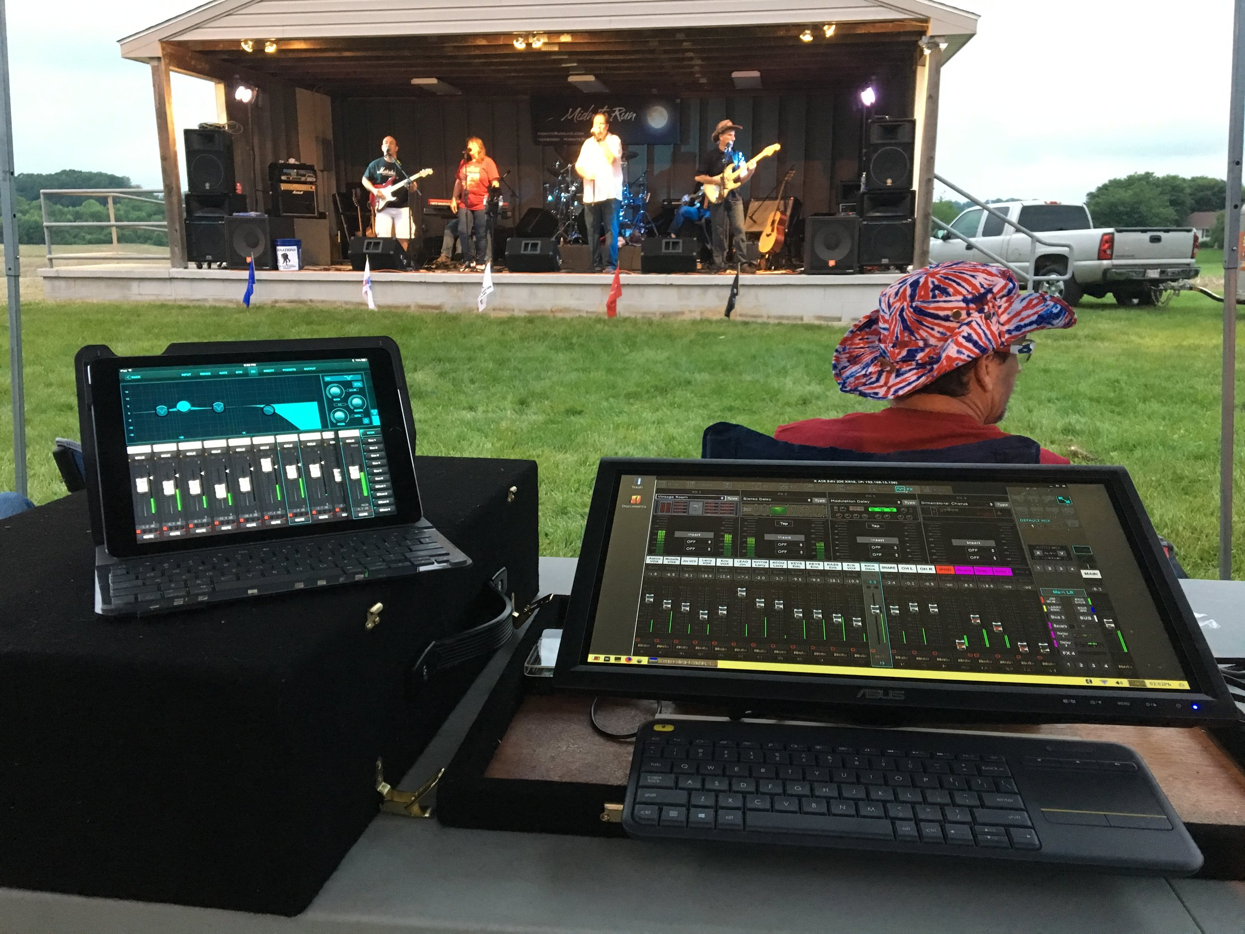 "Mix position for Midnite Run at this year's Gamber Fireman's Carnival. At left is an iPad Air 2 running the latest version of X-Air for iOS. On the right is a Raspberry Pi 3 with an Asus 19.5"" touchscreen monitor and a Logitech wireless keyboard/track pad running X-Air Edit for Raspbian."