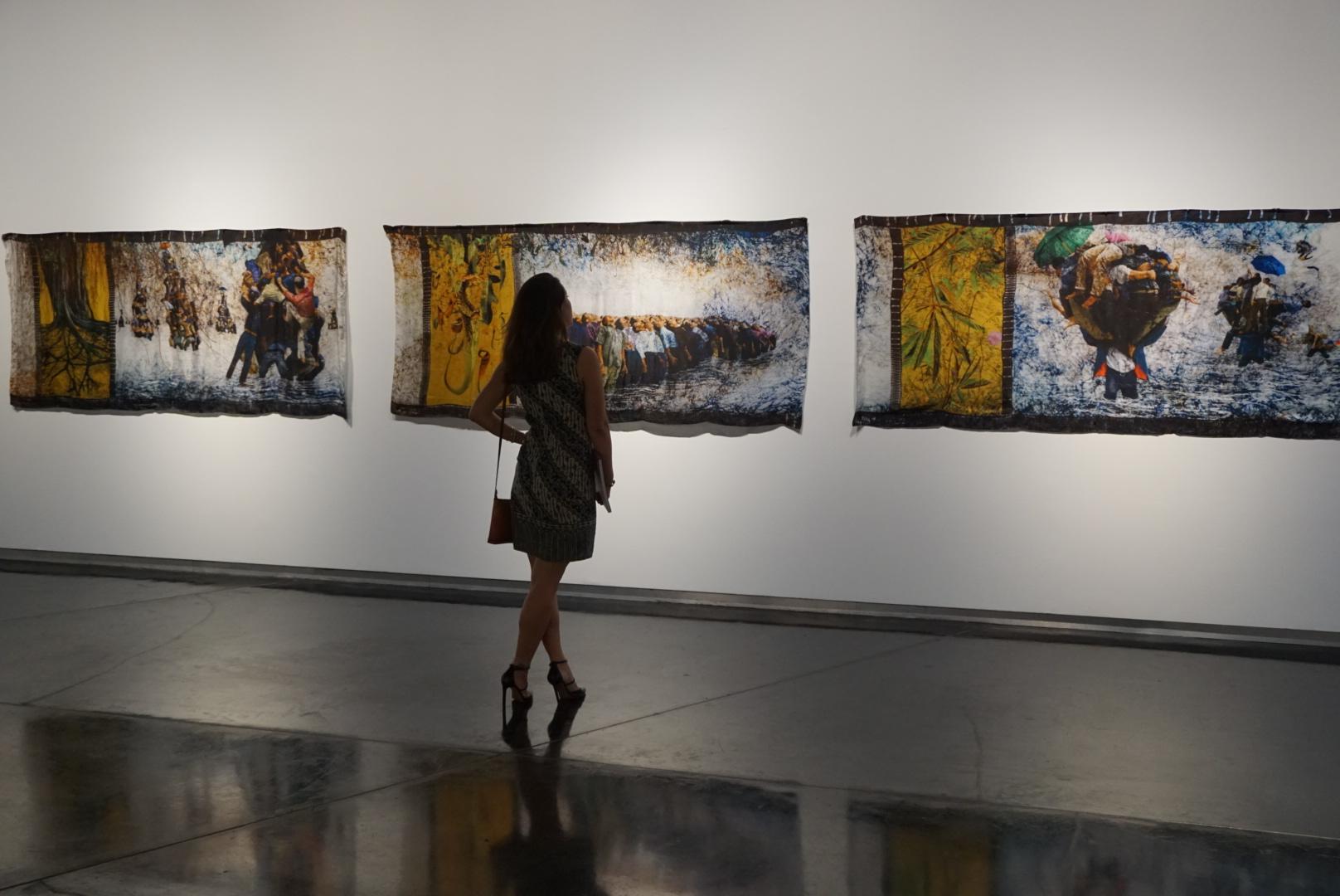 The Orang Besar Series by Yee I-Lann, 2010, features digital print, acid dye, batik canting, all on silk.