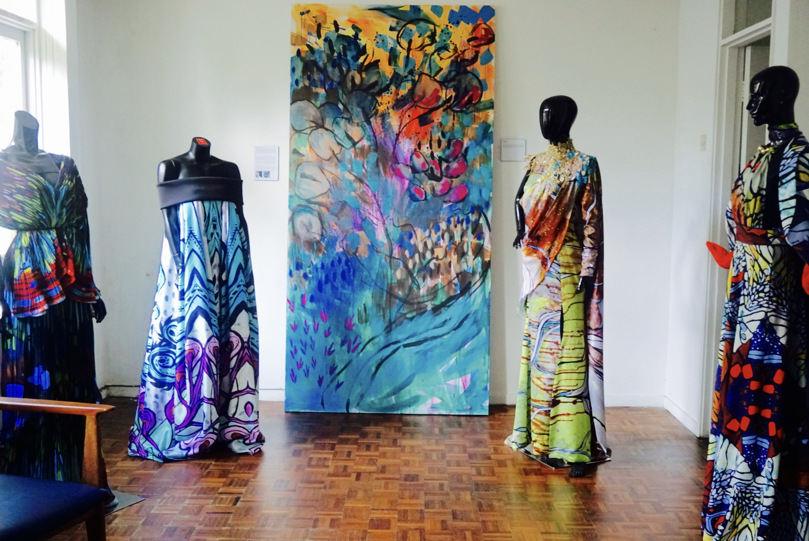 """Creative collaborations done with fashion designers (from l-r) (Alia Bastamam, Faizal Hamid, Adila Long and Syaiful Baharim). In the centre lies """"Lushlife"""", an acrylic on canvas painted this year."""