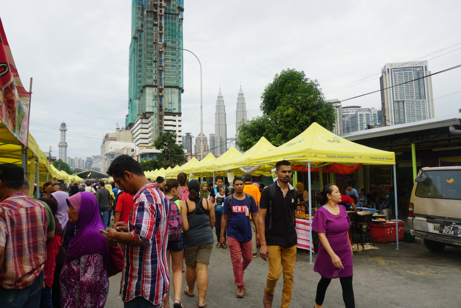 Local residents and office workers browsing and walking along Jalan Raja Alang where the market is located, on the fringes of Chow Kit