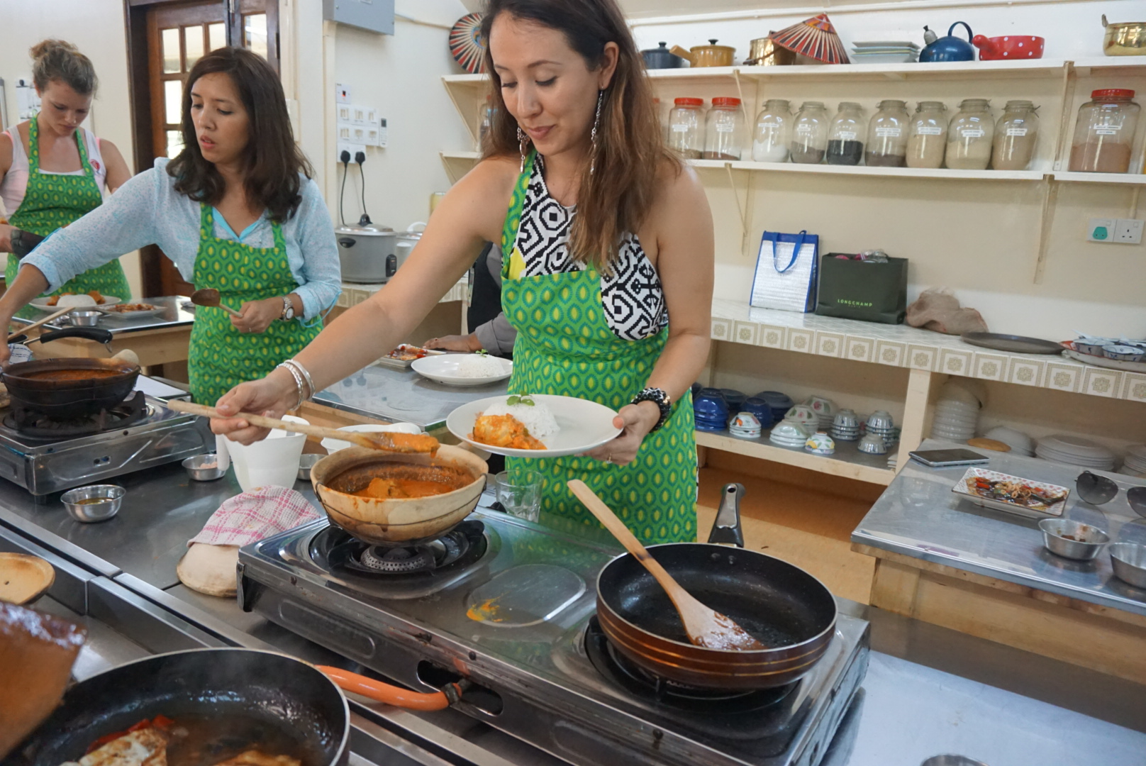 Busy cooks!   Yiga wears the Coffee&Covet's Tati maxi halter dress (more details at the end of the article!)