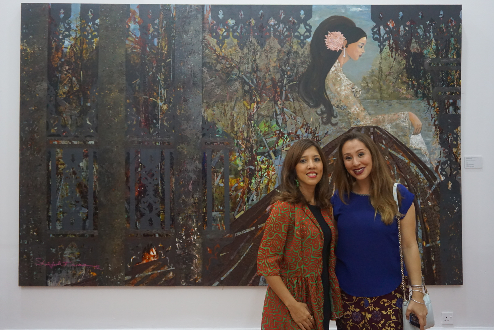 Farena and Yiga of Batik&Bubbles in front of one of the art pieces on display at the Pahang Art Museum.