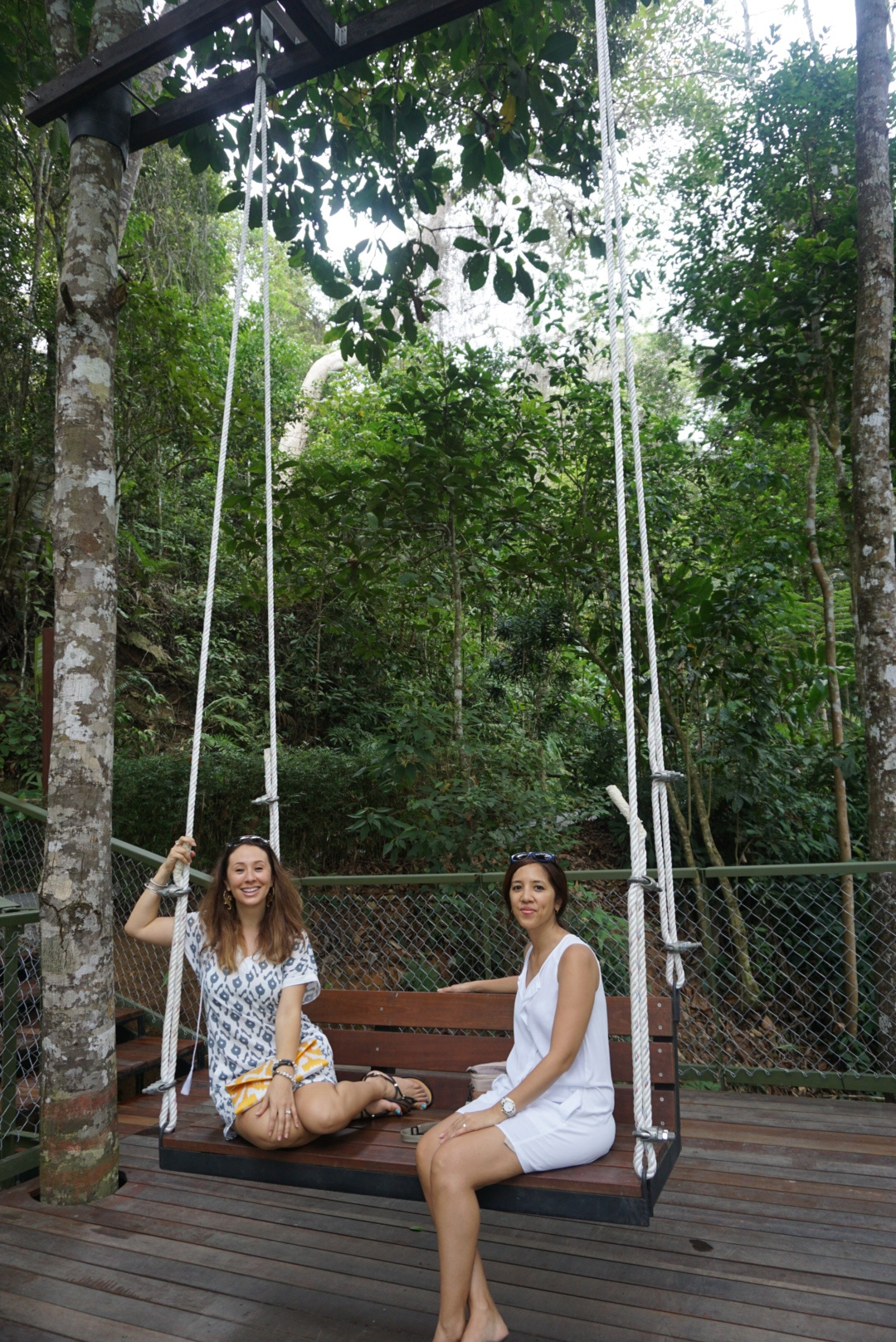 One can just spend the whole day sitting on this swing enjoying the cool and calming breeze!  Yiga is wearing the Coffee and Covet Juliet dress and the Frankitas' Lannie clutch.