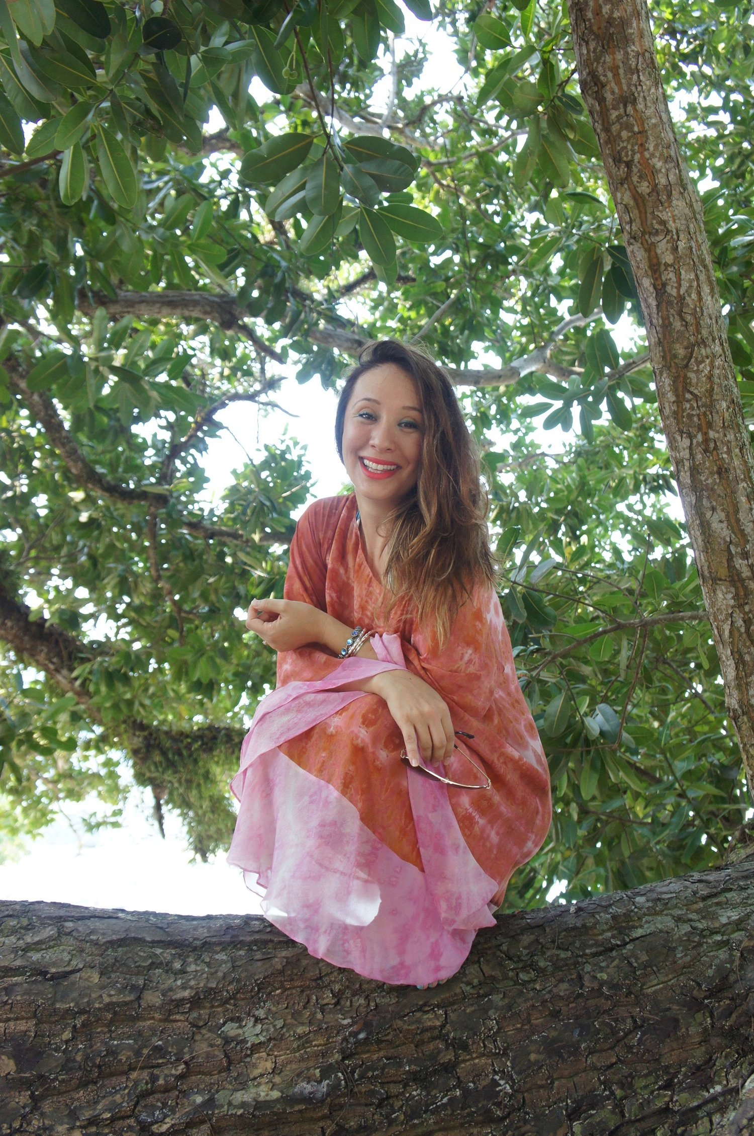 The sunset colors of pink and orange hues in this silk kaftan by  Fern the New Batik  is almost too delicate for the beach, although the colors go perfectly, but perhaps lounging by the pool or hosting a little brunch at home...
