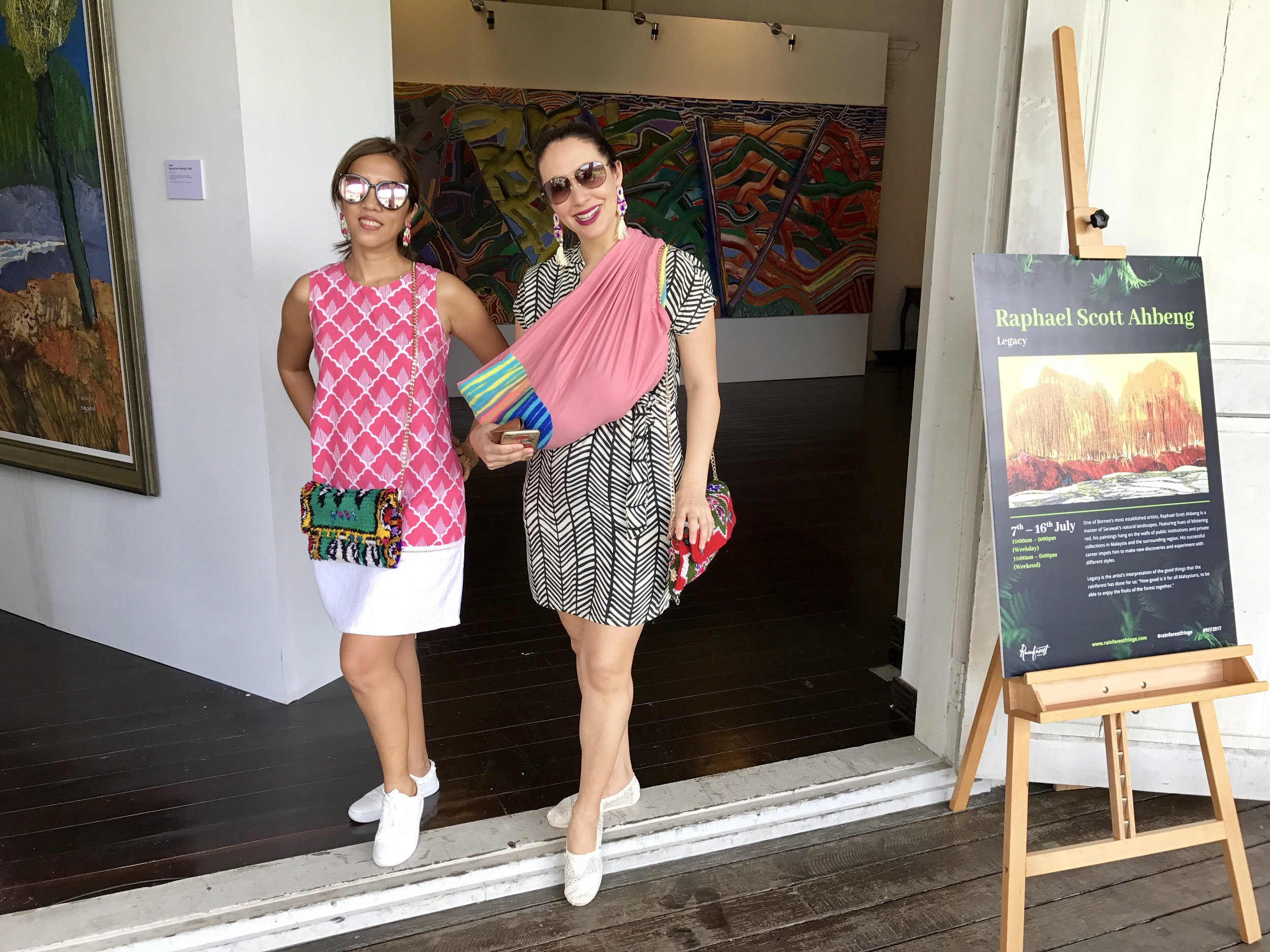 Yiga and I in the Old Courthouse with our funky bags by  Souk Stroll ! Our beautiful earrings are by  Medea Treasures  :)