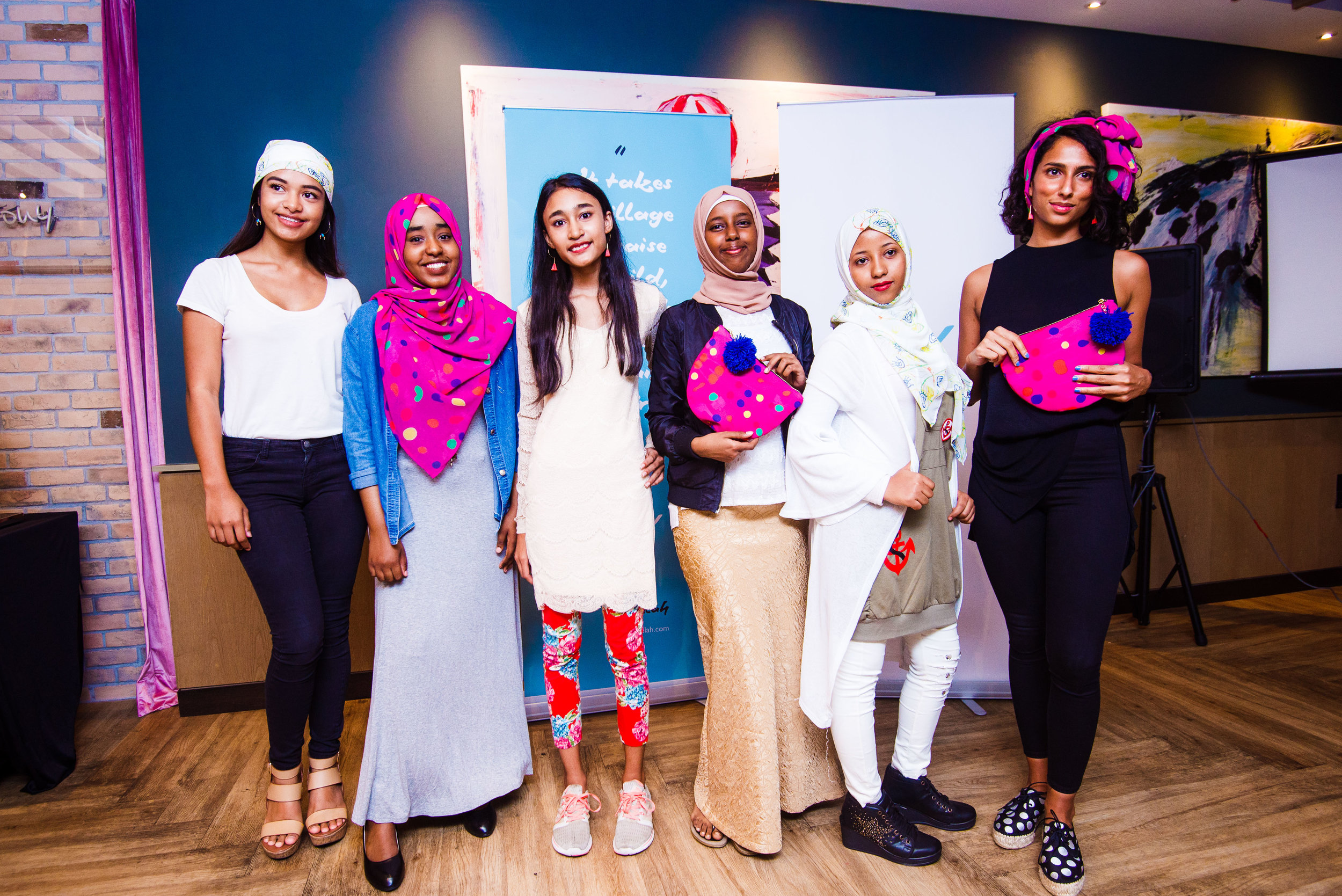 Some of the Fugee School students and Deborah's sister, Rachel, modeling the accessories at the Fugeelah launch!