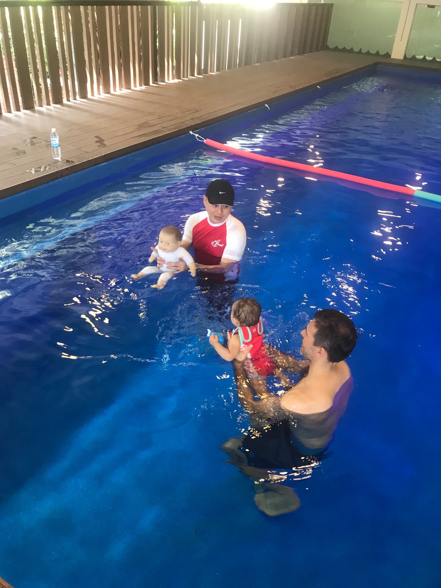 Swim Teacher Bryan demonstrating with Cha-Cha the swim-doll