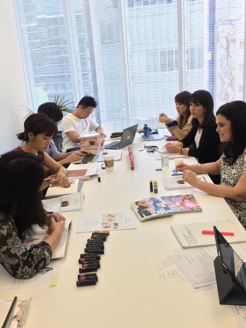 A group of people around a white table working