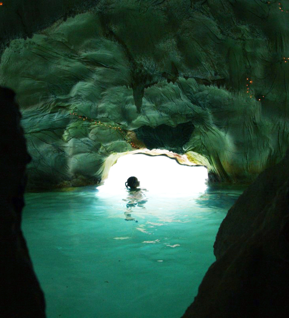 Inside a cave with blue water