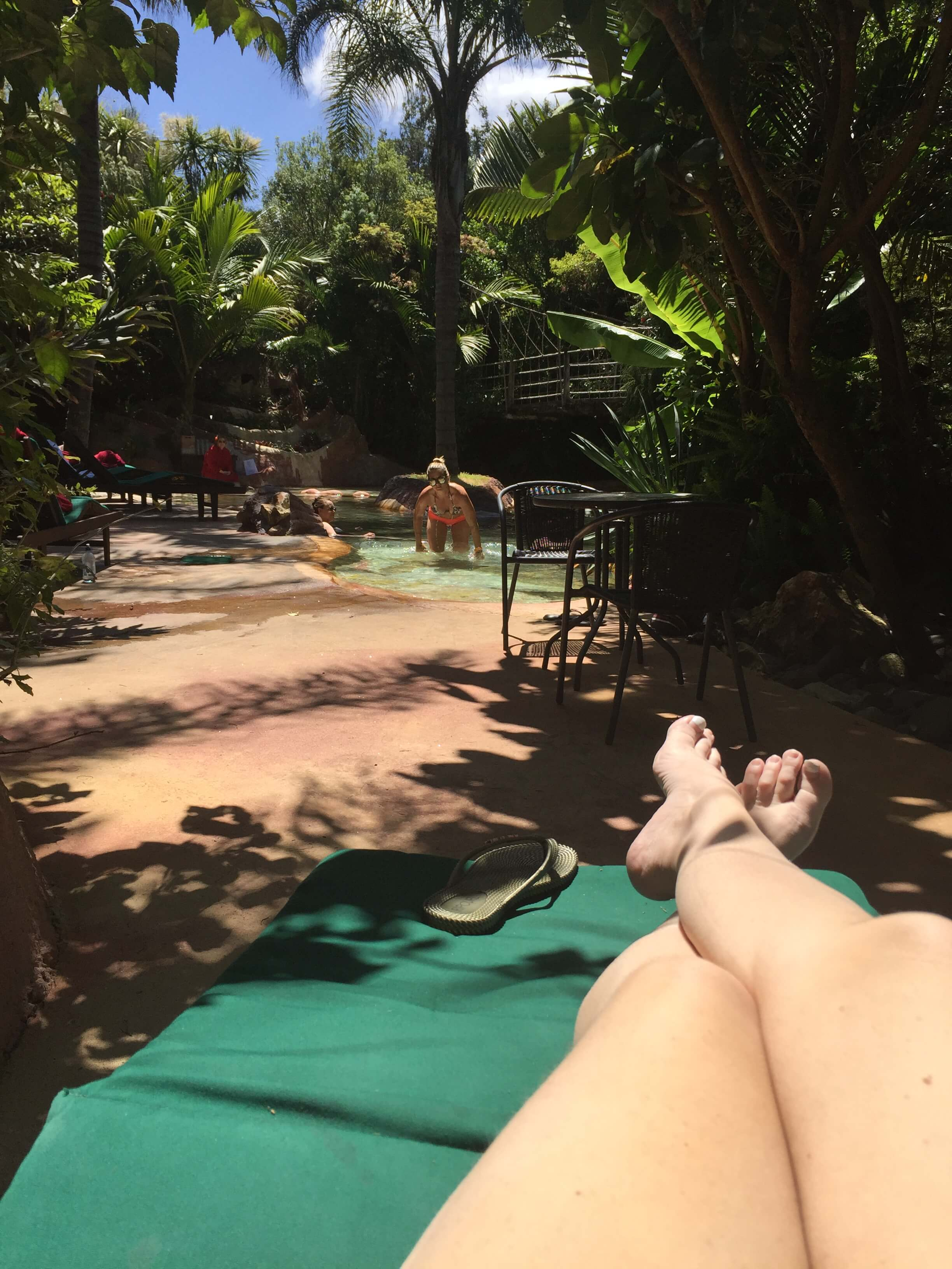 A woman with legs out at a resort