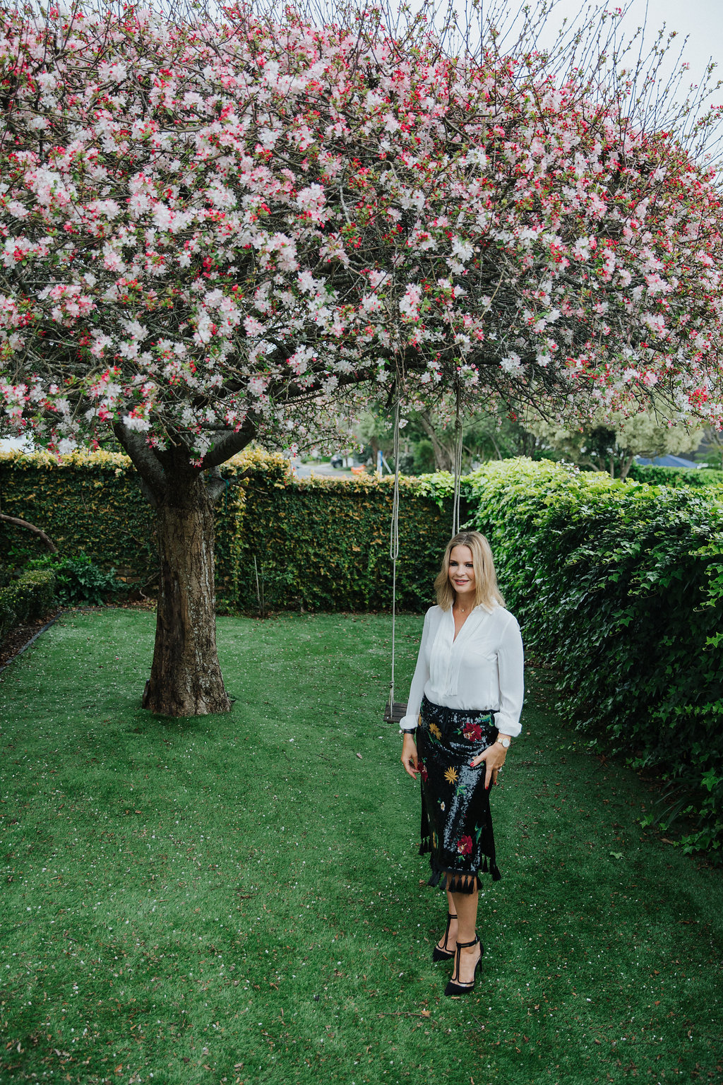 Grove in her garden with her beloved blossom that flowers for only one week of the year.