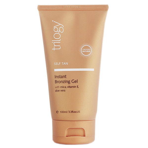 Trilogy Instant Bronzing Gel in a bronze bottle with white and brown labelling