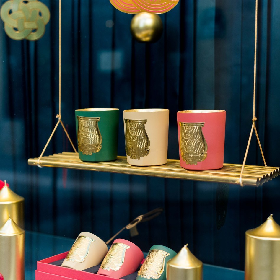 CIRE TRUDON CHRISTMAS CANDLE COLLECTION HANGING ON GOLD SHELF