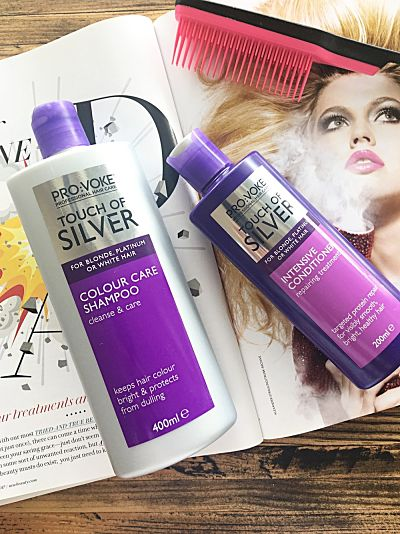 Pro:Voke Touch of Silver, for blonde, platinum or white hair in purple and silver bottles laid out on an open magazine