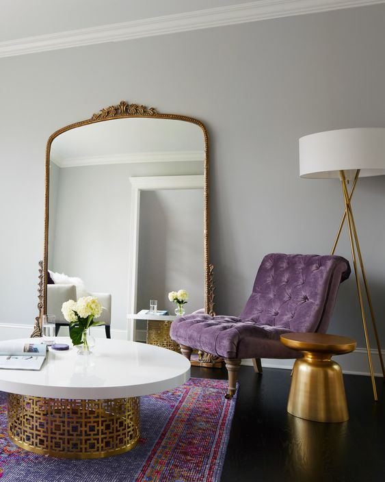 Rom with purple velvet chair and gold and white coffee table
