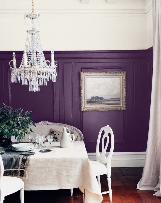 room with purple walls, white ceiling and hanging lights