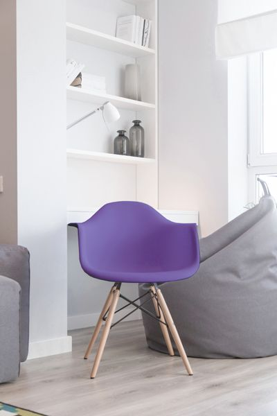 White room with purple chair