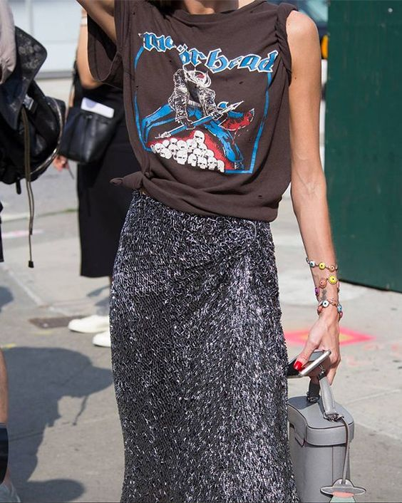 Woman in glitter silver midi skirt and rock band tee