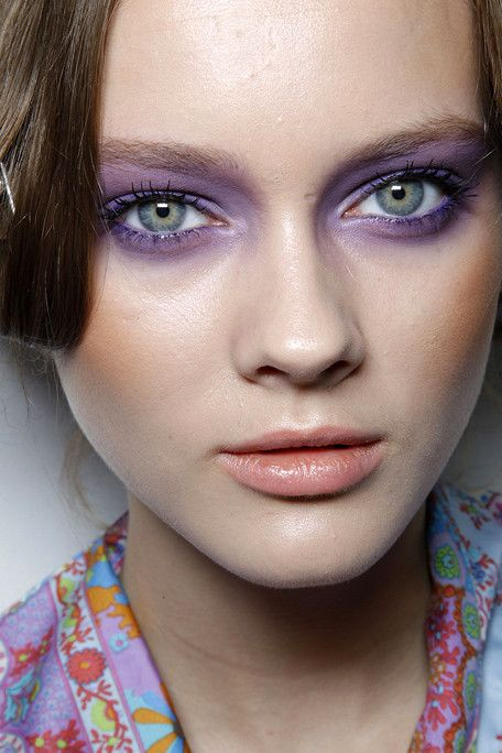 zoomed in shot of model face with purple eyeshadow and neutral lips