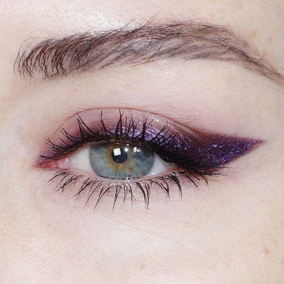 Green eye with purple eyeshadow