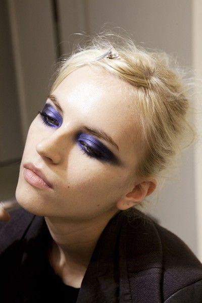 Pale model with dark purple eye shadow
