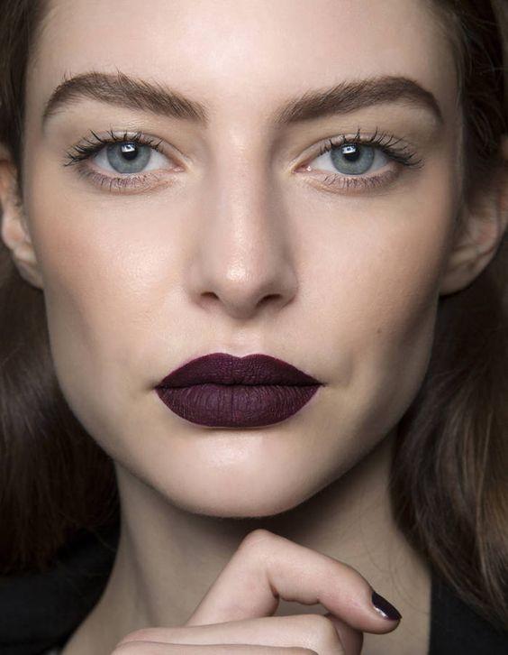 Model face with dark purple lips