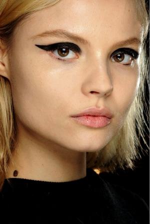 blonde model with thick dark black liquid eyeliner