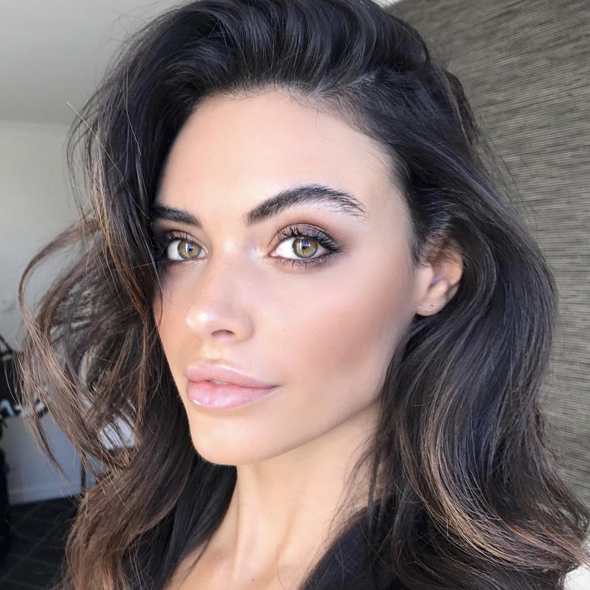 selfie of brunette model with big lips and natural make up