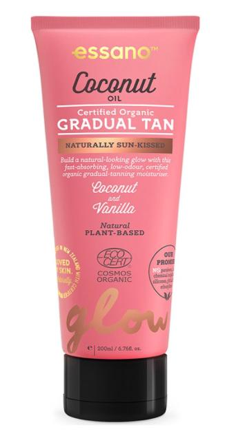 Essano Certified Organic Coconut Oil Gradual Tan in pink bottle sitting on black lid