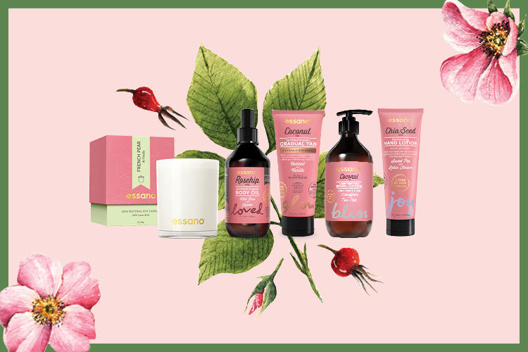 A range of different Essano health and beauty products lined up next to each other against a pink, floral background