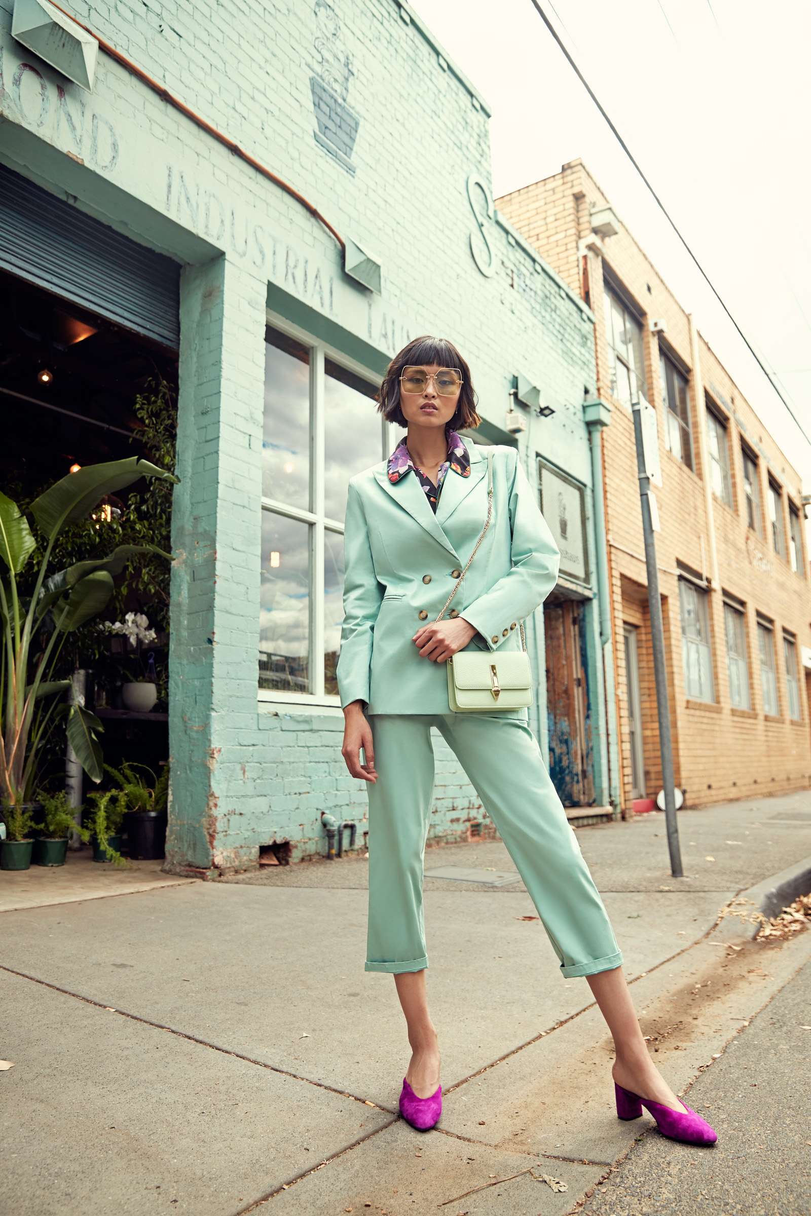 Model  Cynthia Wu  wears Sweepstake Winners  Bobby blazer,  $229,  Bobby trouser , $199 and  Orchid PJ shirt , $229, Karen Walker  Nirvana sunglasses,  $369 and  Molly bag , $350 and Miss Wilson  Kerrey heel , $279. Photographed outside  Glasshaus Inside  . The BeautyEQ team travelled to Melbourne with thanks to   Visit Melbourne  .