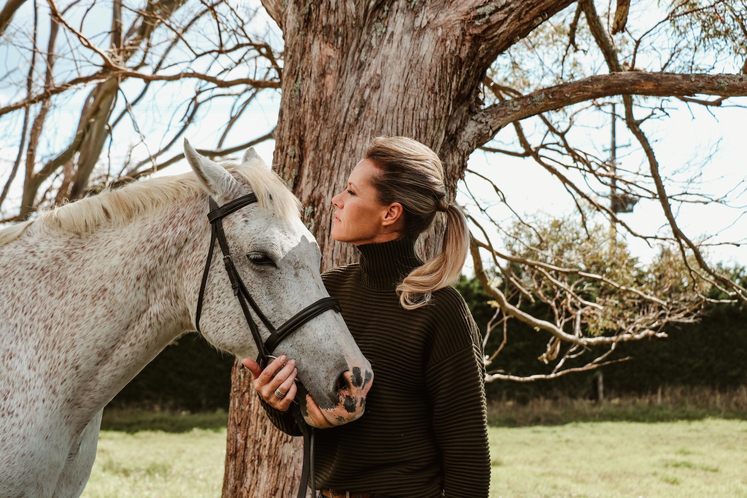 Hugues wearing Victoria Beckham with her daughter's horse Zac