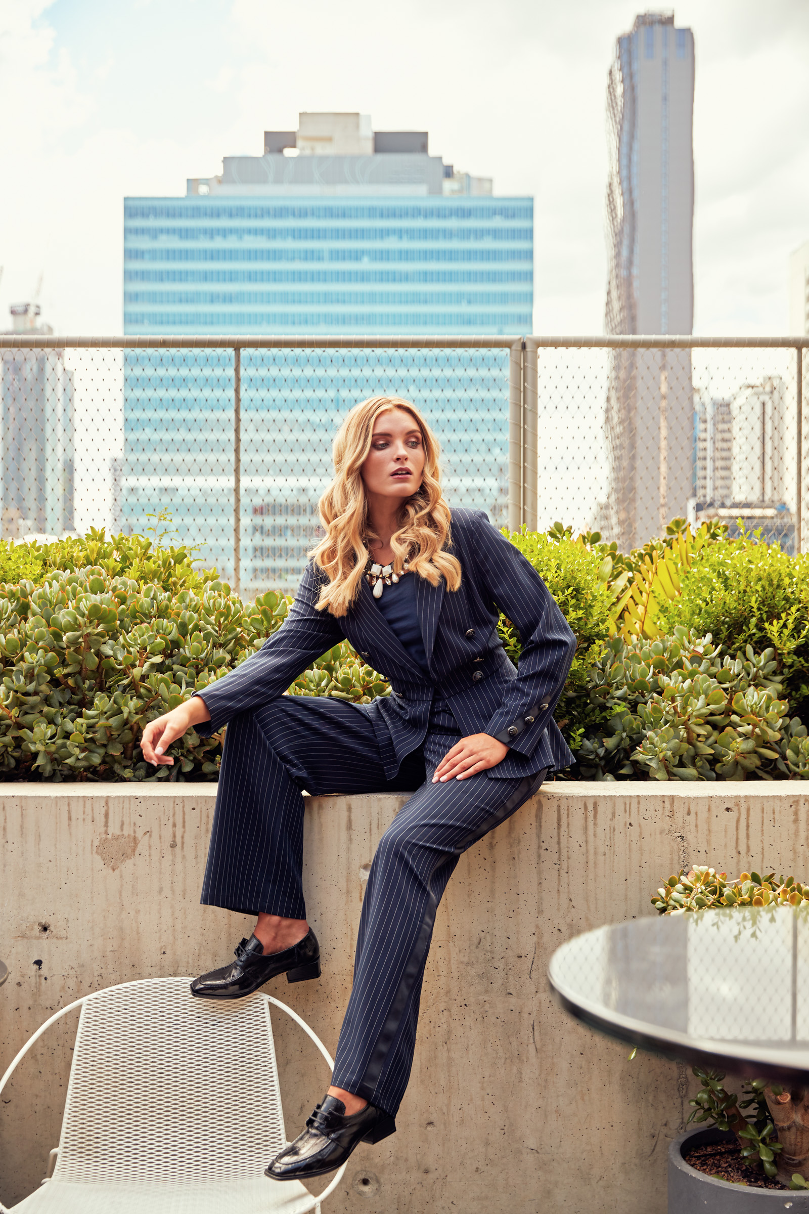 Model wears   Loobie's Story   Sunday Best Jacket, $349,   Loobie's Story   Sunday Best pants, $269,   Four Corners   earrings, necklace, $140, and   Beau Coop   s  Finsey brogues, $429. Photographed on the rooftop at   QT Melbourne  .