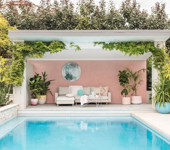 Painted pink wall poolside