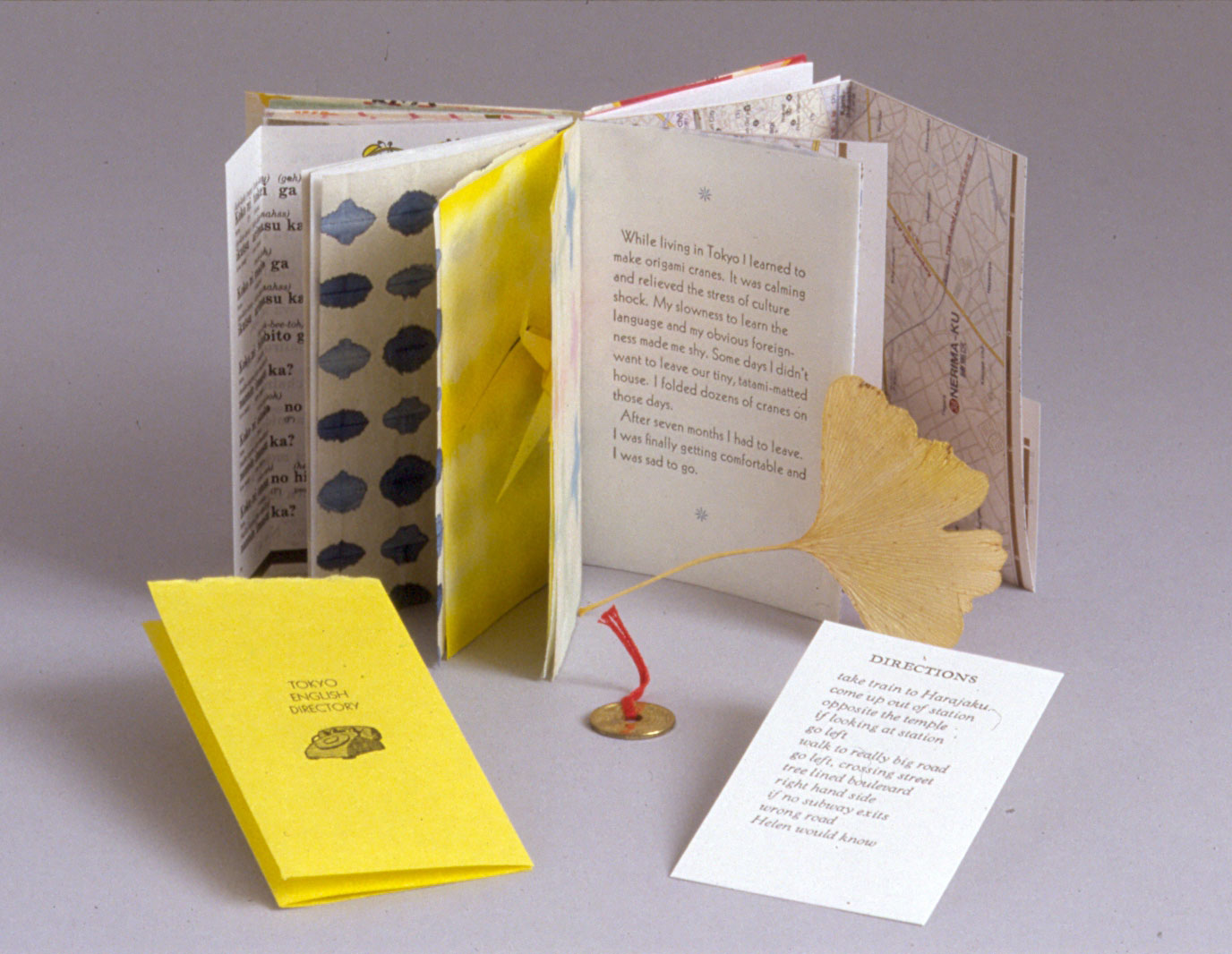 Lost In Japan  ,1999. A collection of micro-memoir pieces, poem, and phonebook, letterpress printed and folded into a scrapbook between sewn-in vintage Japanese papers along with maps, Japanese language book pages, a gingko leaf, and prints from coins and a gingko leaf.