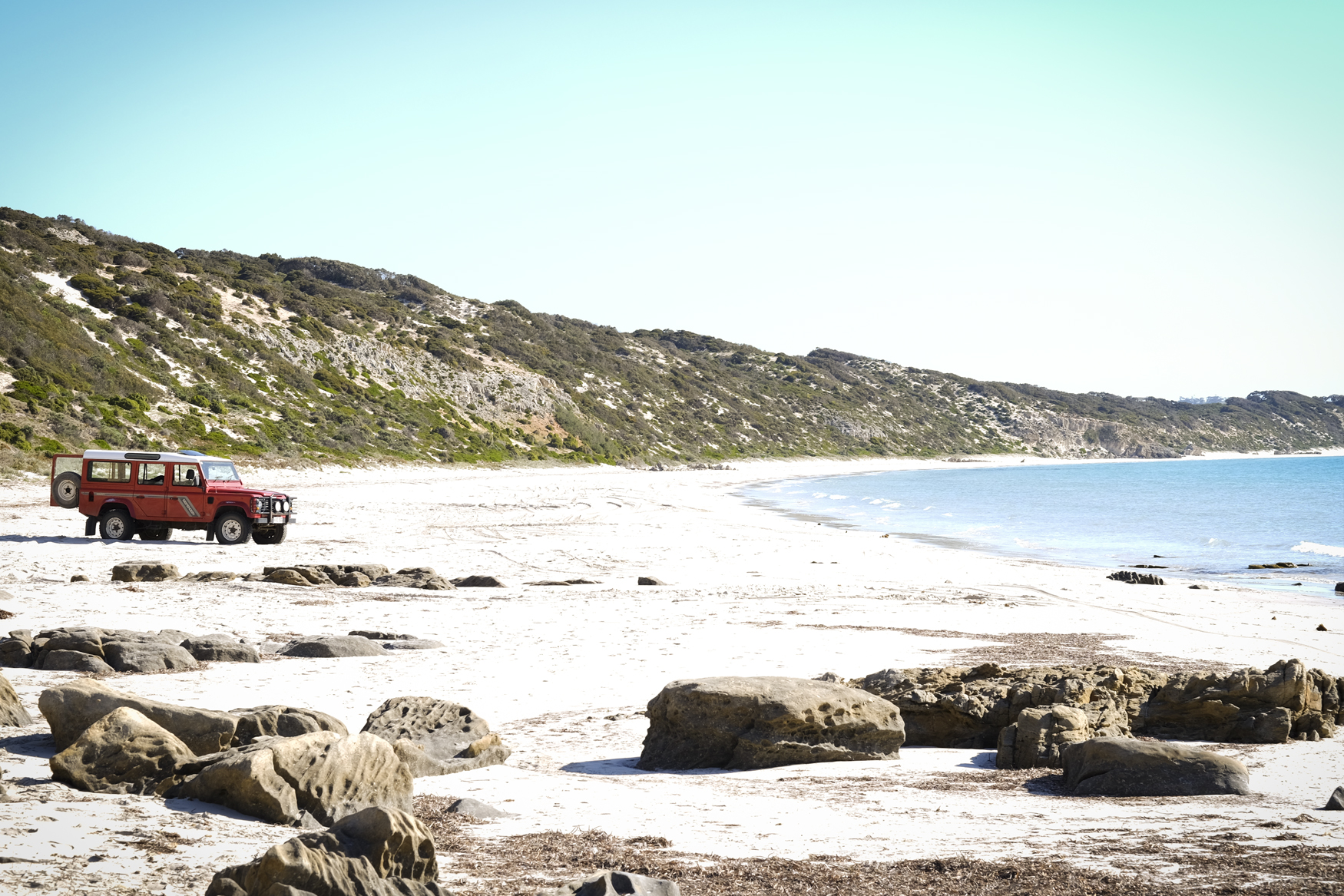 Take your vehicle all the way to the end of the bay. Four wheel drive is recommended - but not essential - if you stay out of the soft sand.