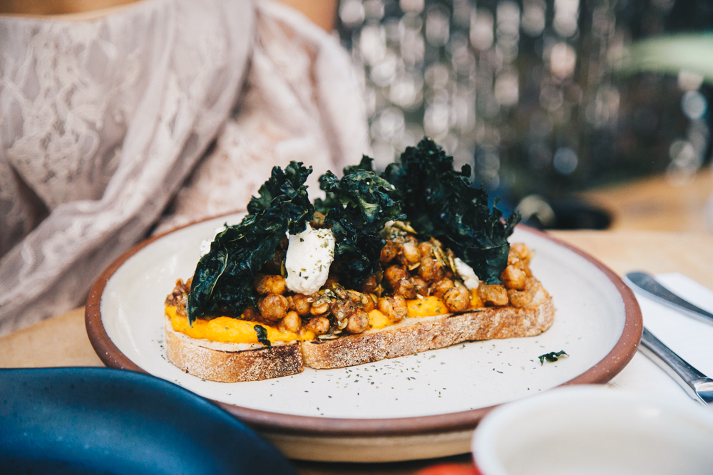 Pumpkin with roasted nuts and seeds on Bruschetta with kale
