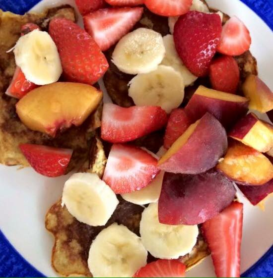 Healthy pancakes topped with Nutella & delicious fruit