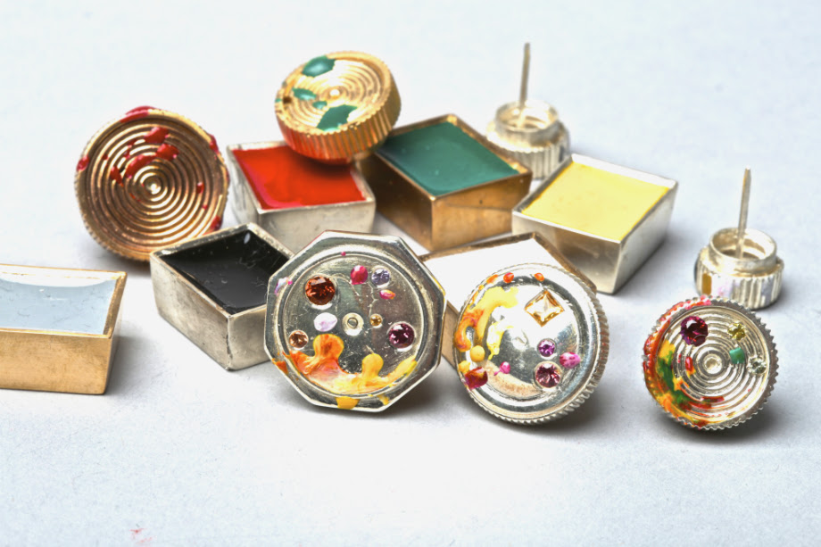 PAINT BLOCK AND TUBE LID EARRINGS &BROOCHES ARE ALIVE WITH BRIGHT JEWELS AND STROKES OF ENAMEL