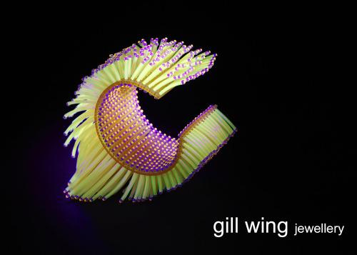 Wanshu-Li bracelet with movement and sound glows in U.V Light