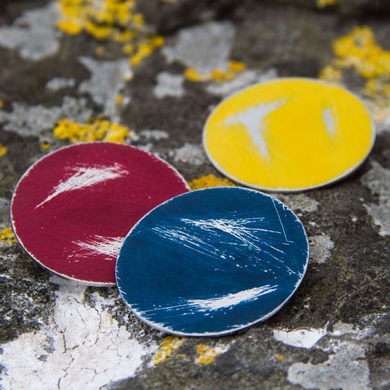 Steel brooches by   Heather McDermott   inspired by the worn paint on boats along the Scottish Coast.