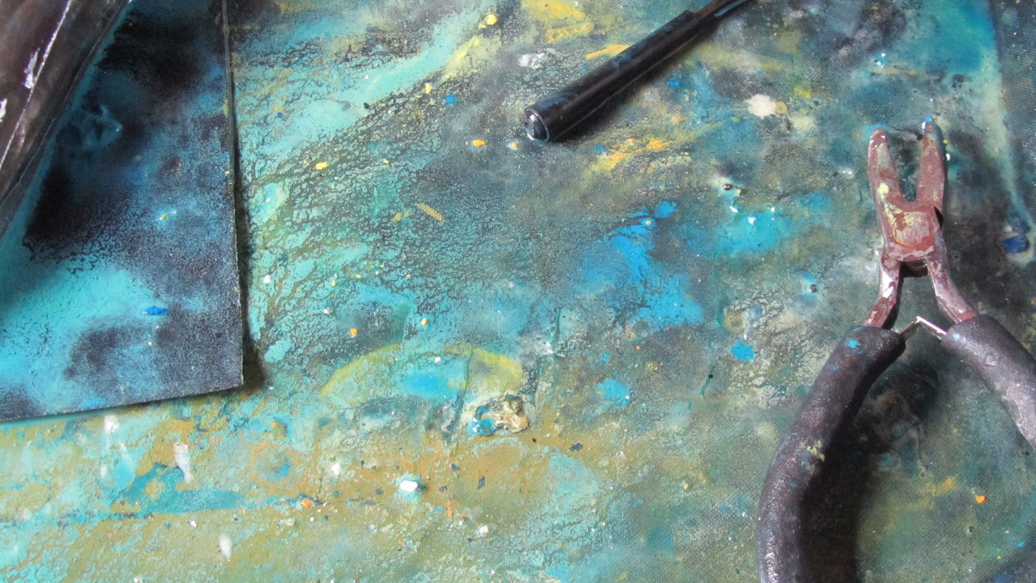 Jade Mellor's Work bench during wet-work. The resin residue makes patterns on the sandpaper.
