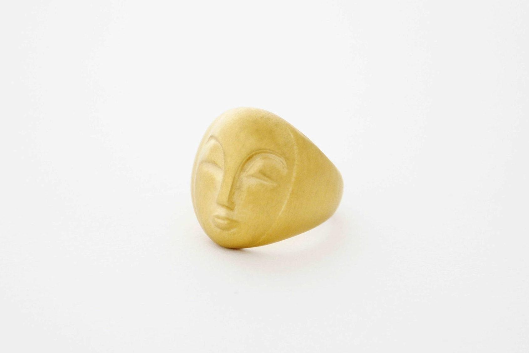 Matt gold moon face ring.jpg