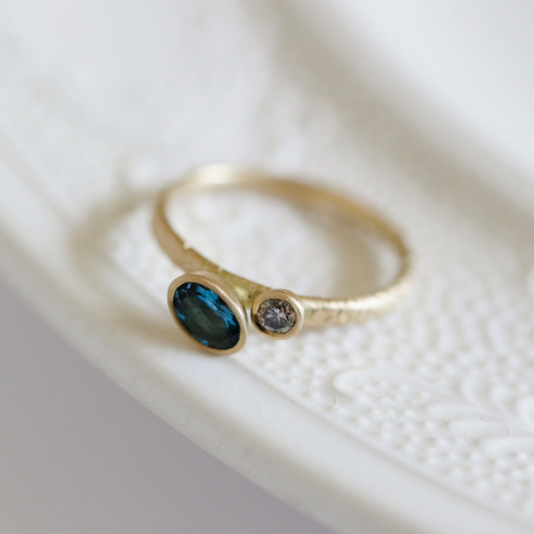alison macleod 11 Catkin off-set aquamarine ring with champagne diamond main.jpg