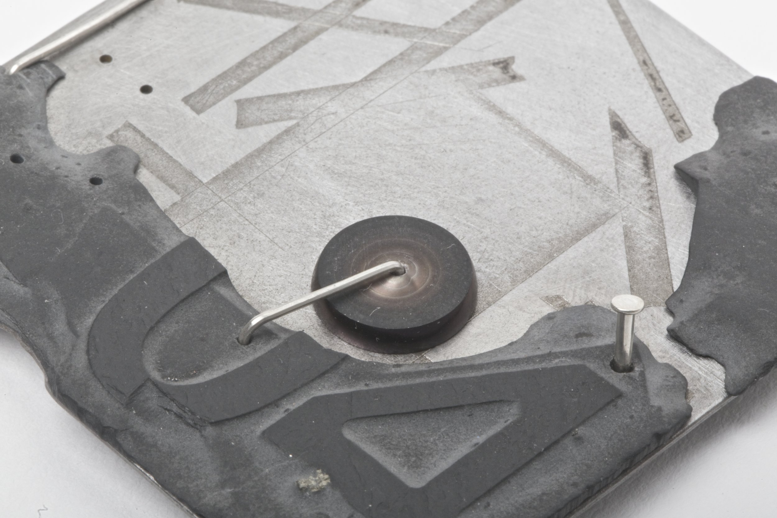 Excess 09 Brooch by Holly O'Hanlon, Etched Steel, slate &silver
