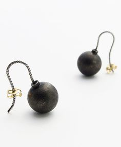 Bomb,  Earrings. electro plated silver, 18ct gold. The iconic shape could remind us of watching classic cartoons on a Saturday morning...