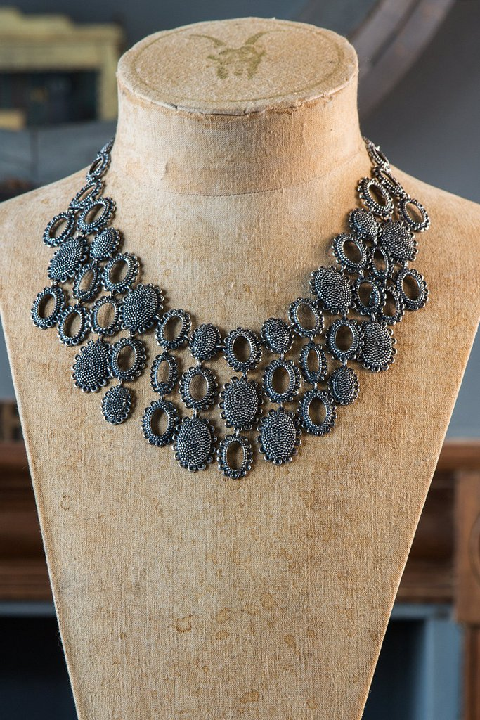 Oxidised Silver 'Baroque Armour Collar' Necklace which expresses Catherine's personality, even in Boiler suits!